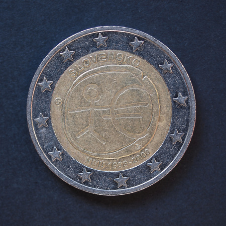 commemorative: Commemorative 2 Euro coin (Slovakia 2009 - 10th anniversary of Euro currency circulating) over black background