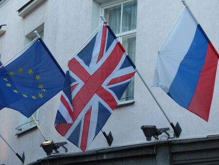 russian flag: EU, UK and Russian Confederation flags