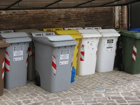 glass paper: MACERATA, ITALY - CIRCA MAY 2014: Waste sorting bins for ecological recycle or reuse of materials such as glass paper cans and disposable items
