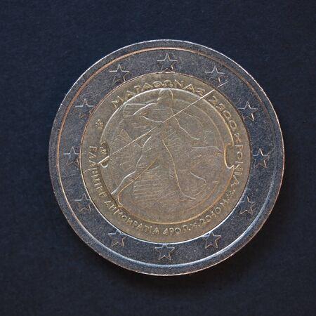 commemorative: Commemorative 2 Euro coin (Greece 2010 - 2500th anniversary of Marathon battle) over black background