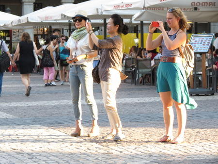 mayor: MADRID, CIRCA JUNE 2015 - Asian tourists taking pictures on Plaza Mayor (Main Square) in Madrid Editorial