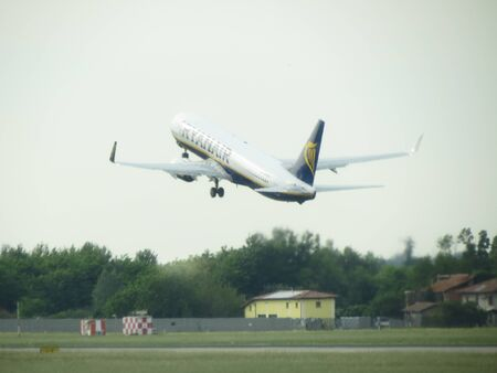 during: BOLOGNA, ITALY - CIRCA MAY 2014: Ryanair aircraft during take off