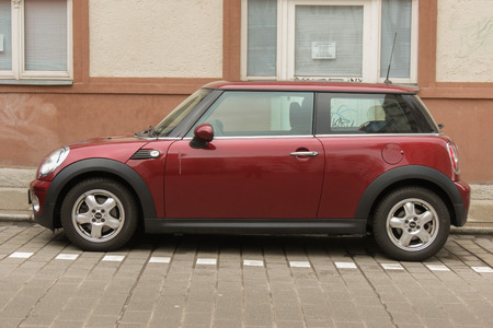 maroon: HALLE (SAALE), GERMANY - CIRCA MARCH 2016: dark red or maroon Mini Cooper car