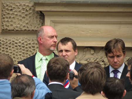 constitutional: BRNO, CZECH REPUBLIC - CIRCA MAY 2013: unidentified politician surrounded by photographers in front of the Constitutional Court Editorial