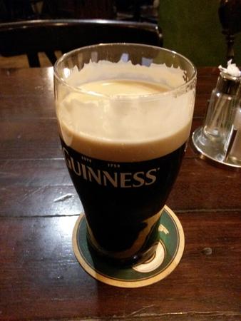 guinness beer: DUBLIN, IRELAND - CIRCA OCTOBER 2015: A pint of Guinness (aka Black stuff)