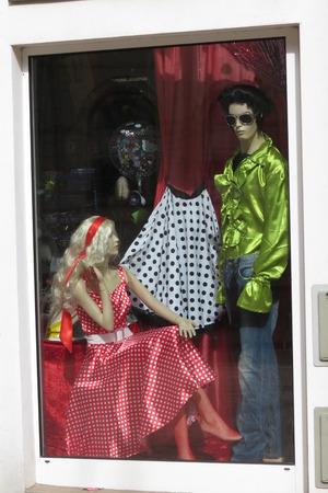 barbie: KOETHEN, GERMANY - CIRCA MARCH 2016: Barbie girl and Elvis man dress on display in a shop window