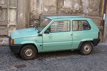 means of transportation: ROME, ITALY - CIRCA OCTOBER 2015: light green FIAT Panda car parked in a street of the city centre