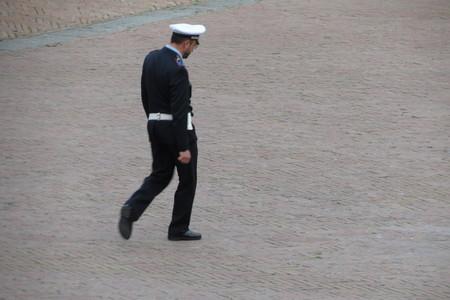 ie: SIENA, ITALY - CIRCA APRIL 2016: Italian Polizia Municipale (i.e. Town Police) officer patroling the main square aka il Campo Editorial