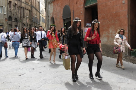 graduated: SIENA, ITALY - CIRCA APRIL 2016: elegantly dressed girls newly graduated and celebrating their goal