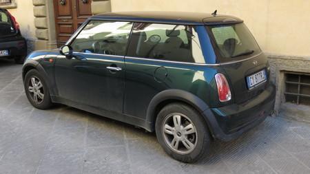 cooper: AREZZO, ITALY - CIRCA APRIL 2016: dark green Mini Cooper car with black roof