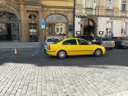 ceska: PRAGUE, CZECH REPUBLIC - CIRCA JUNE 2015: yellow taxi car waiting on a street in the city centre