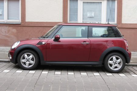 cooper: HALLE (SAALE), GERMANY - CIRCA MARCH 2016: dark red or maroon Mini Cooper car