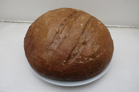 close up food: Round loaf of brown bread food close up