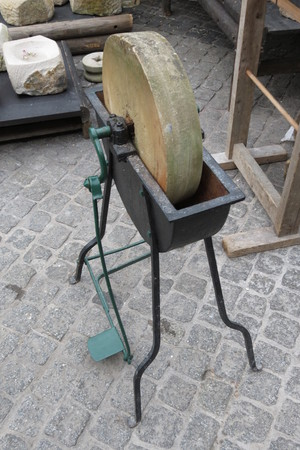 ferrous: An old single-pdeal grindstone tool to sharpen knives, scalpels and other ferrous tools
