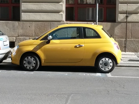 ceska: PRAGUE, CZECH REPUBLIC - CIRCA JUNE 2015: yellow FIAT 500 car (new version) parked on a street in the city centre Editorial