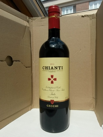 renowned: FLORENCE, ITALY - CIRCA JULY 2014: a bottle of Cecchi brand Chianti red wine