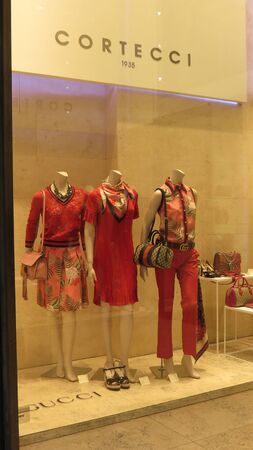 couture: SIENA, ITALY - CIRCA APRIL 2016: Cortecci stylish fashion shop in the city centre displaying high couture clothes, for which Italy is famous worldwide Editorial