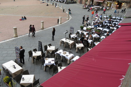unidentified: SIENA, ITALY - CIRCA APRIL 2016: unidentified people having dinner at outdoor terrazzo restaurants in the city centre Editorial