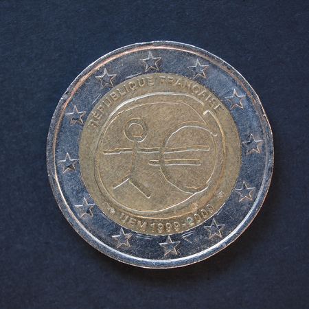10th: Commemorative 2 Euro coin (France 2009 - 10th anniversary of Euro currency circulating) over black background Stock Photo