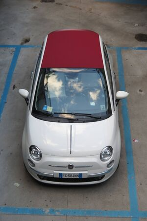 means of transportation: ROME, ITALY - CIRCA OCTOBER 2015: bicolour FIAT 500 car parked in a street of the city centre