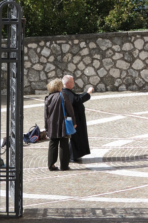 unidentified: MONTECASSINO, ITALY - CIRCA OCTOBER 2015: unidentified senior priest taking a picture with a digital camera