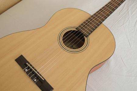 nylon string: SCOTTSDALE, ARIZONA - CIRCA NOVEMBER 2015: Fender classical guitar ESC105 Educational series