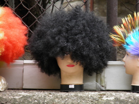 mannequin head: Black curly hair female wig worn by a mannequin head Stock Photo