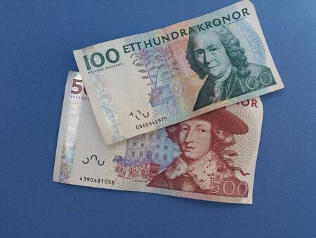valued: Swedish currency SEK from Sweden over blue background