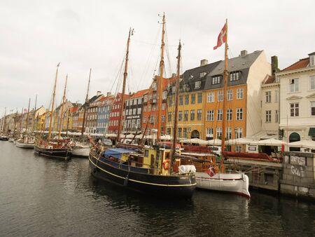 17th: COPENHAGEN, DENMARK - CIRCA JUNE 2016: Pictorial view of the old port Nyhavn (actually meaning  New Port), popular touristic landmark of Copenhagen, built in 17th-century