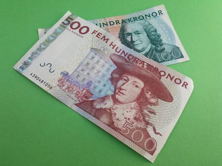 valued: Swedish currency SEK from Sweden over green background