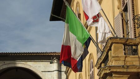 city coat of arms: The national flag of Italy and the flag of the European Union and Siena city council coat of arms Stock Photo