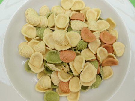 maccheroni: Orecchiette pasta from Apulia, Italy, in three colours (natural, spinach green, beetroot red)