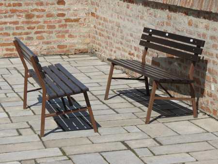 shaped: Traditional shaped wooden benches on a square