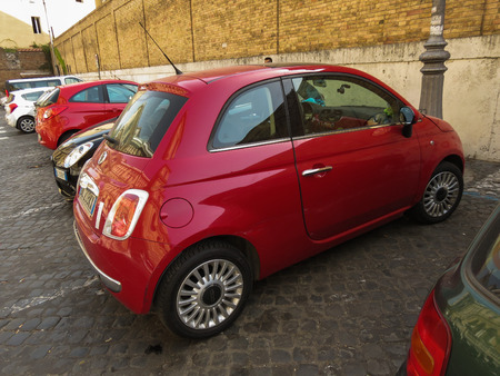 red centre: ROME, ITALY - CIRCA JULY 2016: red Fiat New 500 car parked in a street of the city centre Editorial