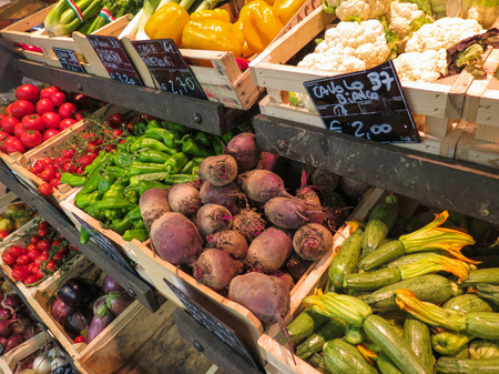 SIENA, ITALY - CIRCA JULY 2016: Fruits and vegetables on display at small grocery store produce market greengrocer Editorial