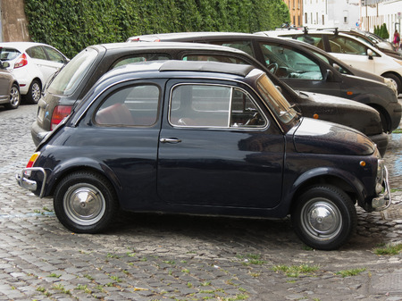 fiat: ROME, ITALY - CIRCA JULY 2016: black Fiat 500 car in a street of the city centre Editorial