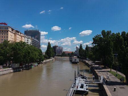 wien: WIEN, AUSTRIA - CIRCA JUNE 2016: river Danube in Wien with piers, tourists and hotels