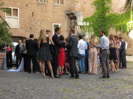 elegantly: ROME, ITALY - CIRCA JULY 2016: Elegantly dressed people at a wedding in Rome Editorial
