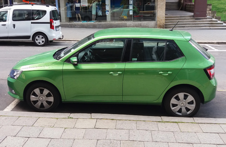 ceska: PRAGUE, CZECH REPUBLIC - CIRCA JUNE 2016: light green Skoda Fabia car parked on a street of the city centre Editorial