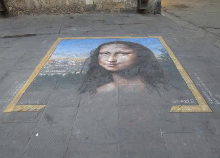 mona lisa: SIENA, ITALY - CIRCA JULY 2016: Mona Lisa painted in the street