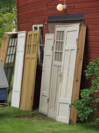 pictoresque: Old wooden doors leaning against a wall