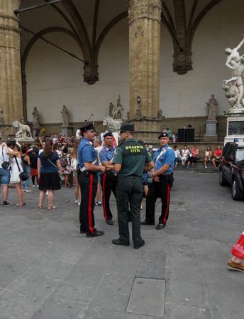 vigilante: FLORENCE, ITALY - CIRCA JULY 2016: Italian Carabinieri police with Spanish Guardia Nacional vigilante men Editorial