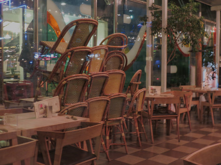 closing time: Tables and chairs of a dehors alfresco bar restaurant pub after closing time Editorial