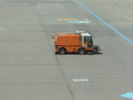 ceska: PRAGUE, CZECH REPUBLIC - CIRCA JULY 2016: Street sweeper cleaning vehicle Bucher cityCat 5000 with revolving brushes cleaning the airport runway