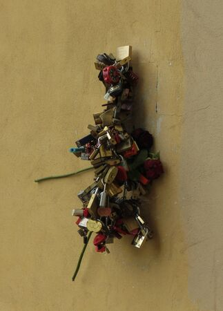 sweethearts: FLORENCE, ITALY - CIRCA JULY 2016: Love lock padlock sweethearts locked to a fence to symbolize eternal love