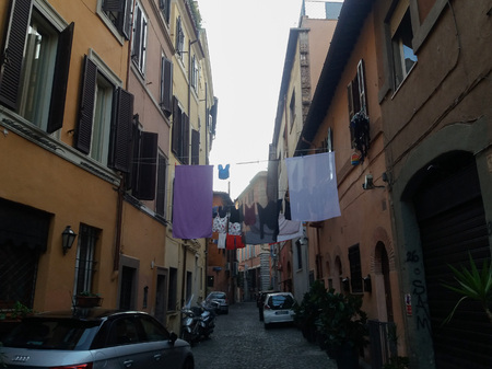 house robes: ROME, ITALY - CIRCA JULY 2016: Clothes drying drip hanging from a wire in the street