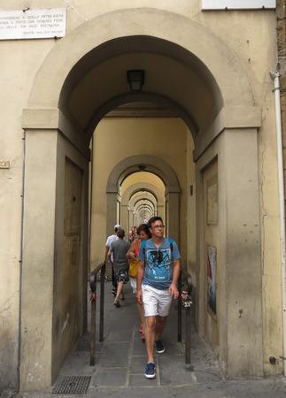 portico: FLORENCE, ITALY - CIRCA JULY 2016: portico near Ponte Vecchio, under the Vasarian Corridor, with tourists