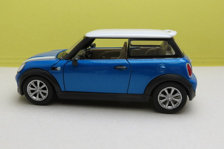means of transportation: OXFORD, UK - CIRCA OCTOBER 2015: miniature representation of a light blue Mini Cooper car (2013 version) with white roof produced as a childrens toy in China, circa 2014
