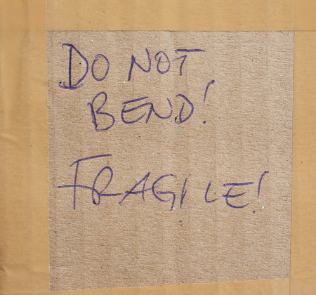 danger box: Do not bend! Fragile! handwritten on a corrugated cardboard