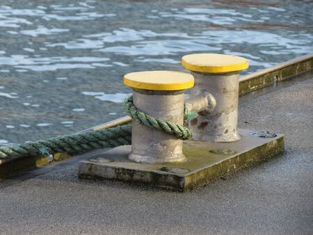 mooring bollard: Double mooring bollard with a rope by a canal